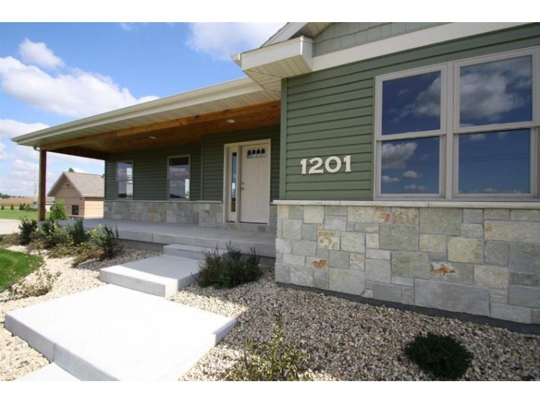 1201 N Madison St, Waunakee, WI by First Weber Real Estate $429,500