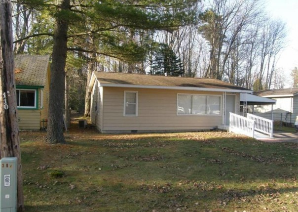 311 W Tawas Lake Road East Tawas, MI 48730 by American Associates Inc. $64,500