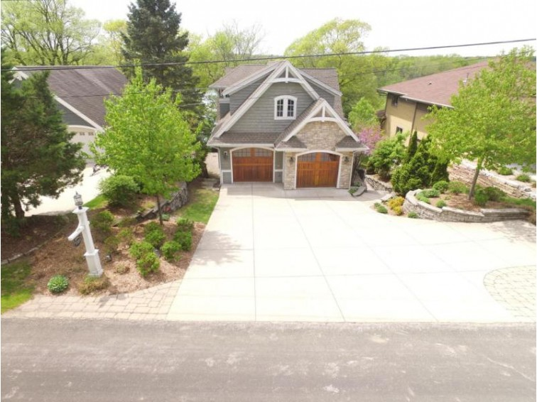 5989 Artist Bay Rd, West Bend, WI by Coldwell Banker Residential Brokerage $1,495,000