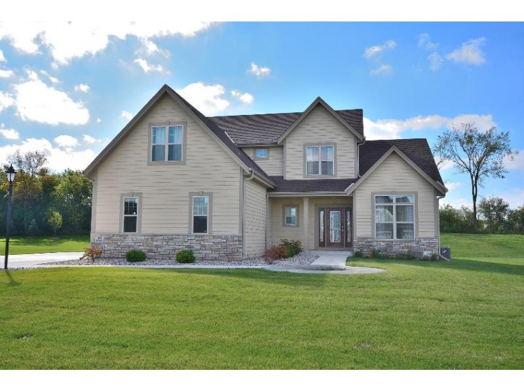 N60W13671 Weyerhaven Dr, Menomonee Falls, WI by First Weber Real Estate $439,000