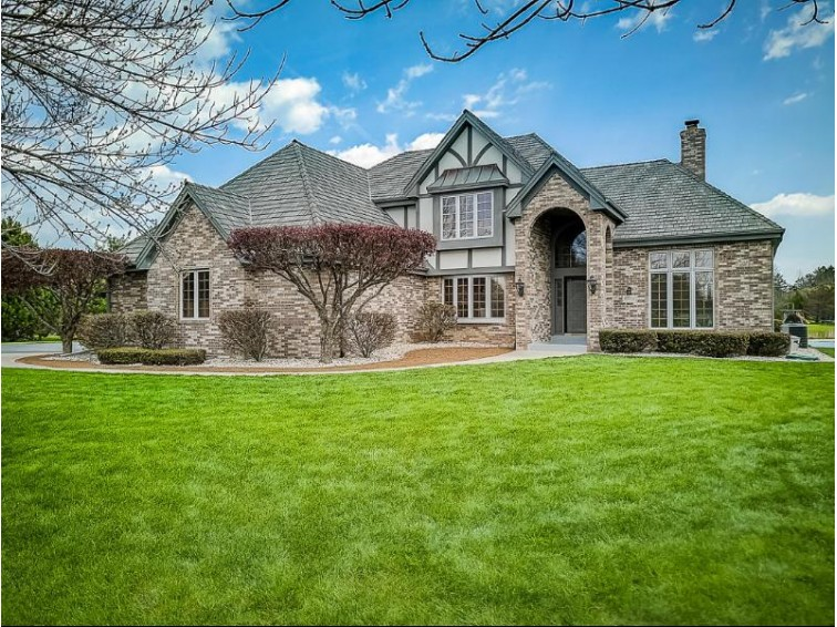 10704 N Beechwood Dr, Mequon, WI by Powers Realty Group $619,000