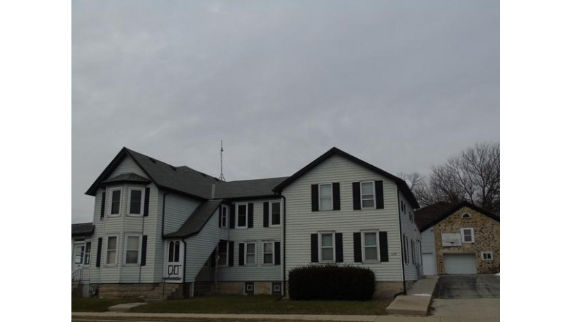 115 Kettle Moraine Dr N 115A + 117 Slinger, WI 53086-9701 by Gadow Realty LLC $329,900
