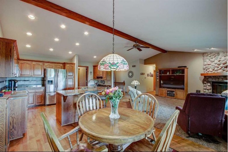 1031 Olympic Dr, Slinger, WI by Restaino & Associates Era Powered $310,000