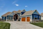 1675 Whistling Hill Cir, Hartland, WI by First Weber Real Estate $824,900