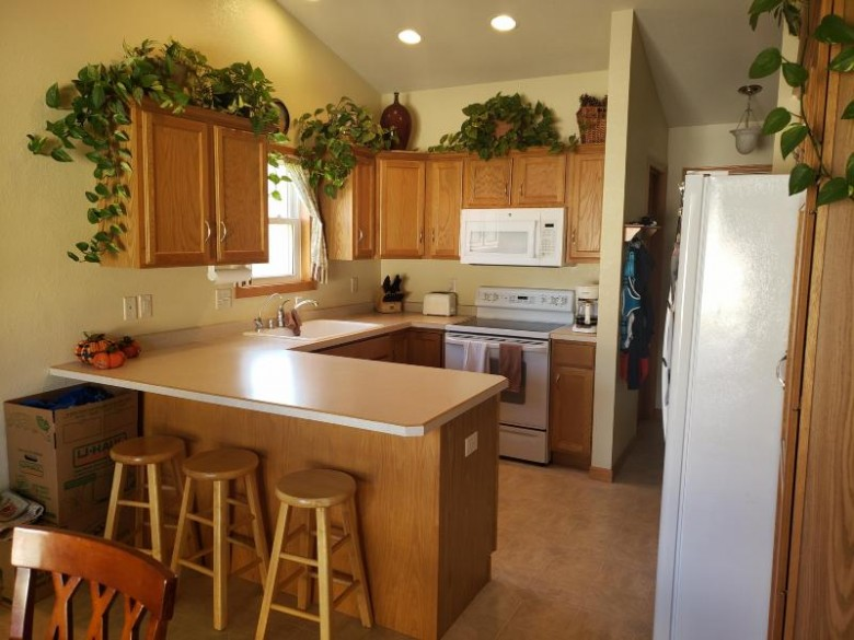 1300 Goldcrest Ct, West Bend, WI by First Weber Real Estate $257,500