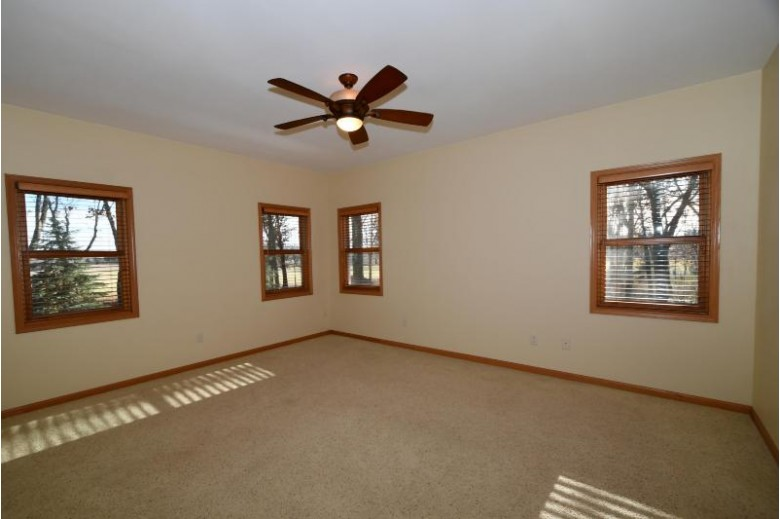 N5750 Whitetail Ct, Green Lake, WI by Emmer Real Estate Group $424,900
