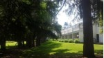 266 Victorian Village Dr 27, Elkhart Lake, WI by Salzwedel Woods & Water Real Estate $69,900