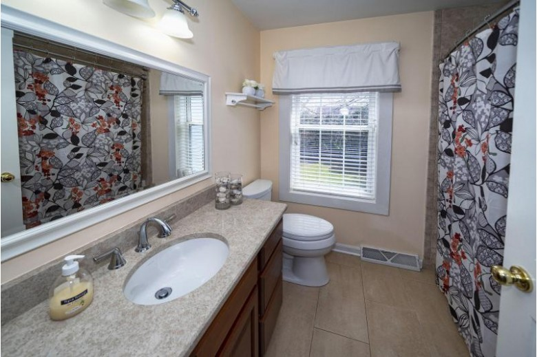 7729 W Stonewood Dr Franklin, WI 53132 by First Weber Real Estate $399,000