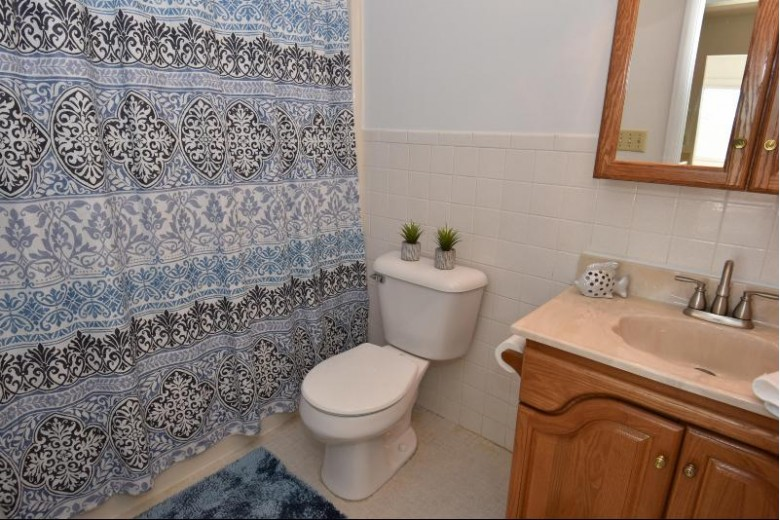 10640 N Ivy Ct 9 Mequon, WI 53092-5037 by First Weber Real Estate $145,000