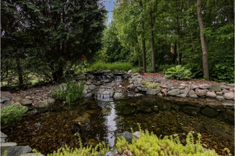 W242N7285 Ridgewood Rd, Sussex, WI by First Weber Real Estate $464,900