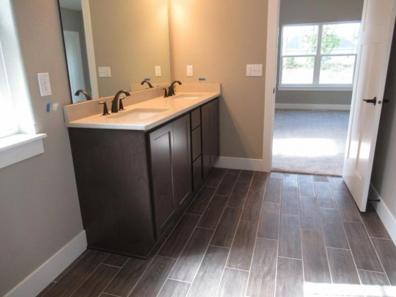 2470 Sunrise Ct Slinger, WI 53086 by Kaerek Homes, Inc. $409,990