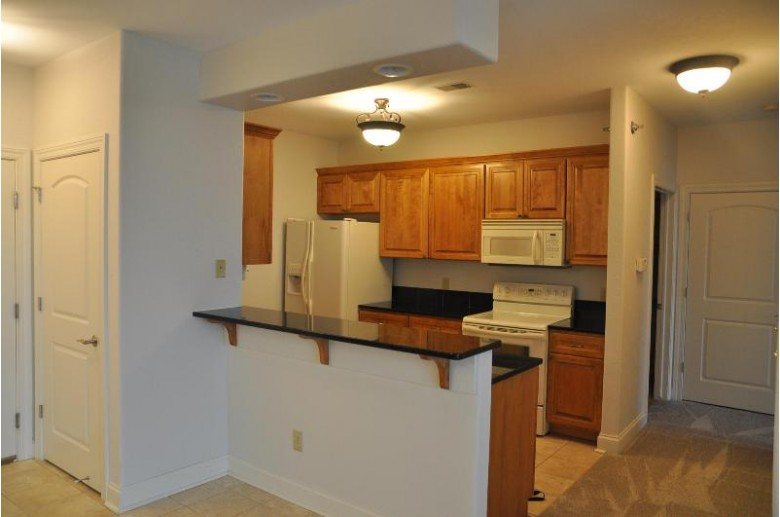 2912 N University Dr 304E Waukesha, WI 53188-1493 by Homestead Realty, Inc~milw $224,900