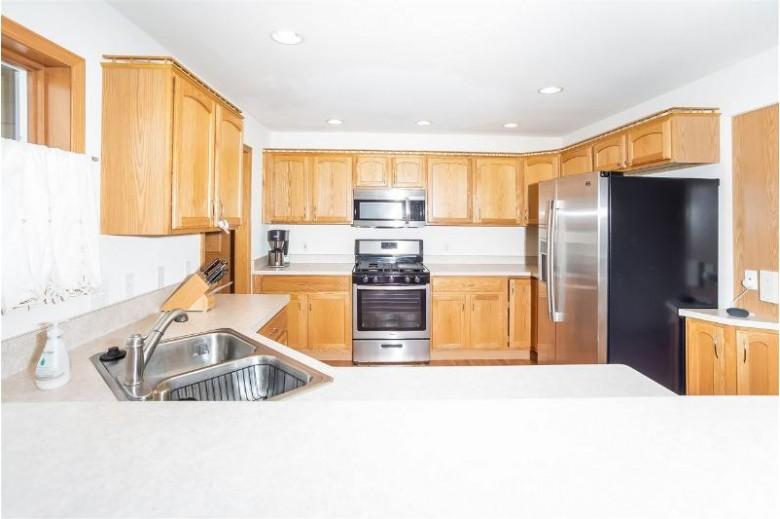 5204 Teaberry Ln Fitchburg, WI 53711 by Stark Company, Realtors $334,900