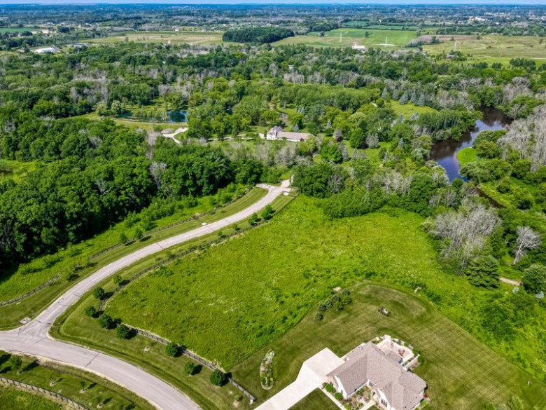 2348 W Saddlebrook Ln 142N, Mequon, WI by Powers Realty Group $295,000