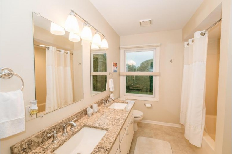 8 Sprucewood Ct Wind Point, WI 53402-5316 by Re/Max Newport Elite $394,900