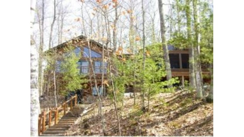 5715 Point O Pines Rd Manitowish Waters, WI 54545 by Schmidt-Haus Realty $674,900