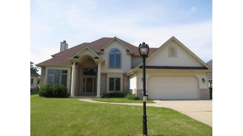 1032 W Violet Dr Oak Creek, WI 53154-3720 by In Town Realty Group Inc. $300,000