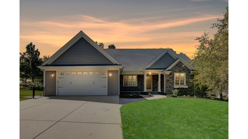 109 Lower Woodford Cir West Bend, WI 53090-1088 by Shorewest Realtors $379,900