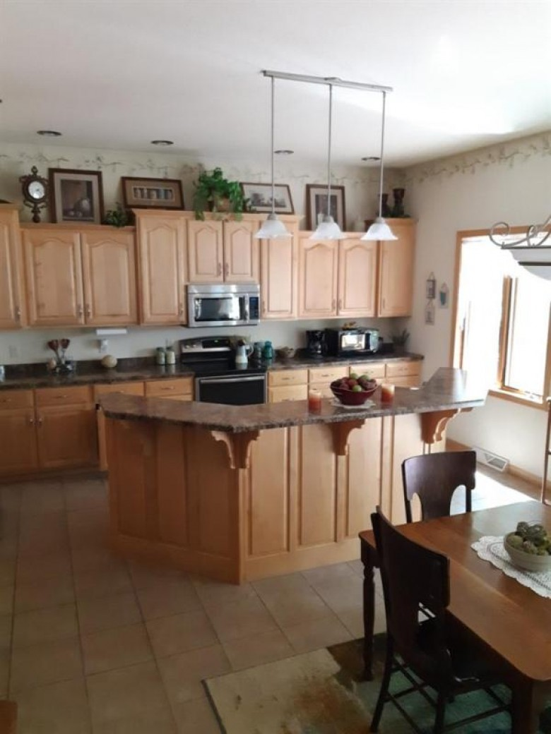 9404 Anastasia Drive, Weston, WI by Coldwell Banker Action $475,000