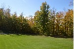 8434 Hwy 2 Saxon, WI 54559 by Lakeplace.com - Vacationland Properties $599,000