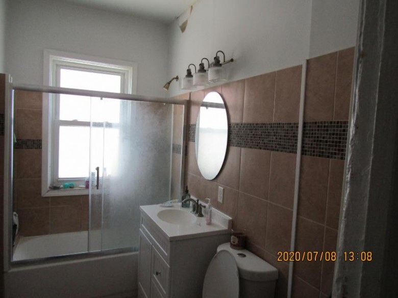 1832 S 7th St, Milwaukee, WI by Dream House Realties $124,900