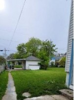 3167 N 11th St, Milwaukee, WI by One Day Real Estate Service $107,500