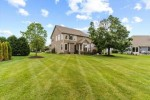1835 Springhouse Dr Oconomowoc, WI 53066-4860 by First Weber Real Estate $659,900