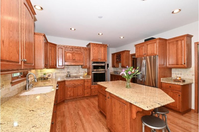 7110 W Lafayette Pl, Mequon, WI by First Weber Real Estate $625,000