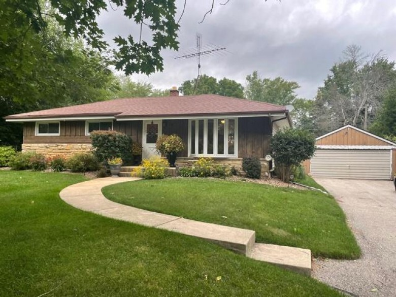 W122 Belleview Ave, Oconomowoc, WI by Badger Realty Team-Cottage Grove $270,000