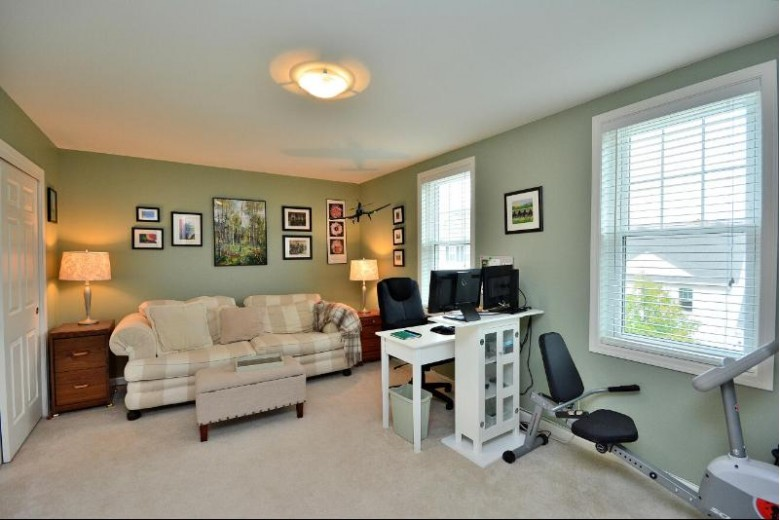 1217 Woodbury Commons B Waukesha, WI 53189-7792 by First Weber Real Estate $279,900