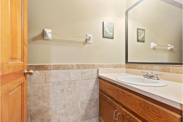 2411 Willowood Dr A Waukesha, WI 53188-1577 by First Weber Real Estate $189,900