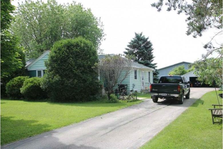 765 N Washburn Street, Oshkosh, WI by Adashun Jones, Inc. $1,999,999