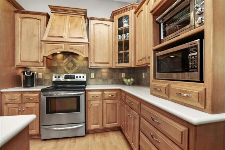 1530 Whitetail Drive, Neenah, WI by Coldwell Banker Real Estate Group $519,900