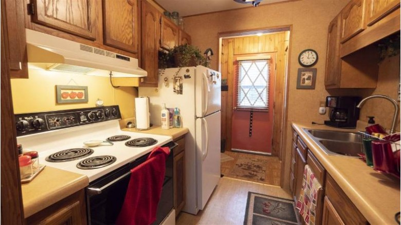 7615 Circle Drive Waupaca, WI 54981 by First Weber Real Estate $119,900