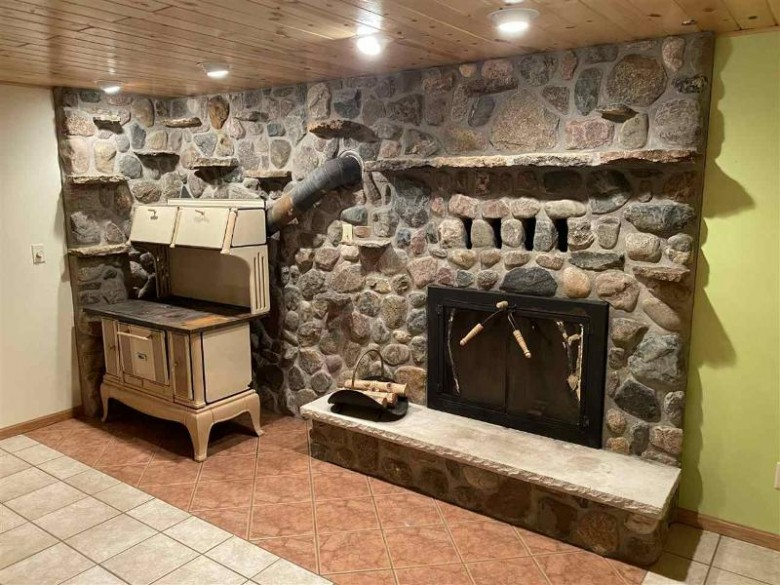 W9831 Miscuano Island Drive, Daggett, WI by Coldwell Banker Real Estate Group $359,900