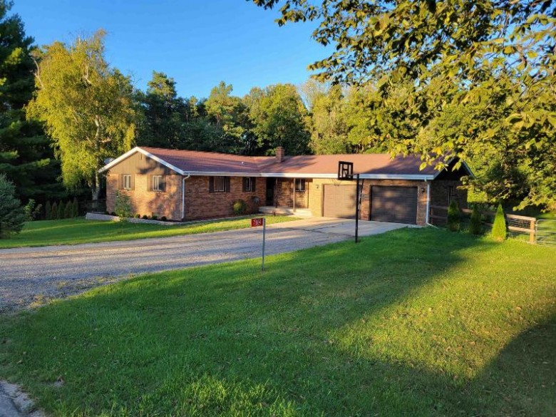 7884 N Pine View Drive, Edgerton, WI by RE/MAX Heritage $324,900